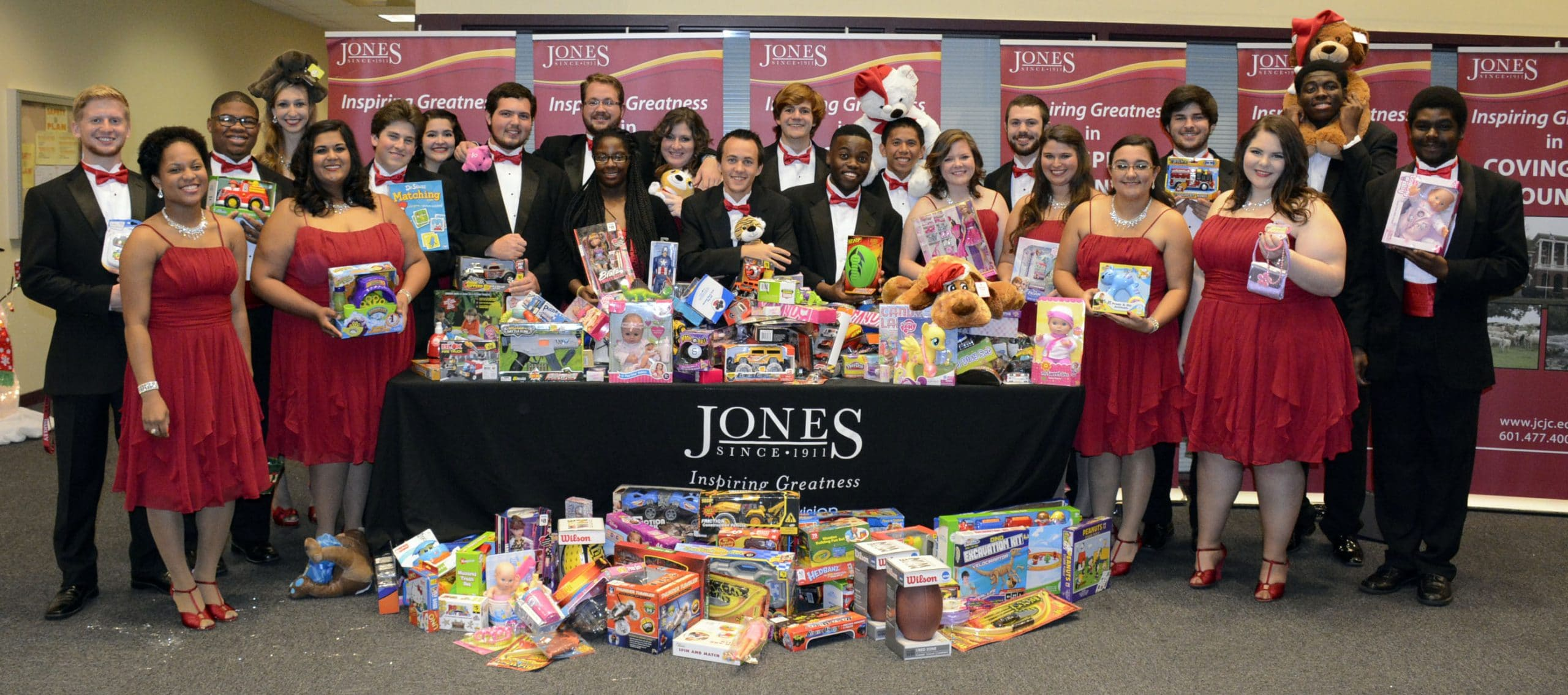 """JC Voices and JC Jazz students were proud of the number of toys received as admission to the group's concert, """"A Jingle Jazz Christmas.""""  The donated toys will all go to children in the Pine Belt enrolled in the """"Toys for Tots"""" program.  Pictured are some of the JCJC students from both performing groups and they are pictured left to right in the front row: Ashley Adams, Laurel; Rohini Malkani, Hattiesburg; Reagan Arnold, Collins; Doby Herring, Waynesboro; Sophia Daniel, Hattiesburg; Jordan Sanders, Ellisville; Karsten Smith, Hattiesburg; Ashley Mills, Waynesboro; Morgan Smith, Laurel; Elizabeth Hensarling, Patterson, CA and Roxie Hudgins, Collins.  Pictured in the back row, left to right:Caleb Guilbeau, Ellisville; Shaquille Shelwood, Ellisville; Lauryn Easley, Laurel; Savannah Scafide, Long Beach; Harlan Mapp, Hattiesburg; Leah Dueitt, Neely; Steve Jones, Starkville; Sam Cruz, Pensacola, FL; Daniel Coats, Taylorsville; Cale Green, Laurel; David Walker, Laurel and Gary Young, Ellisville (between the two rows)."""