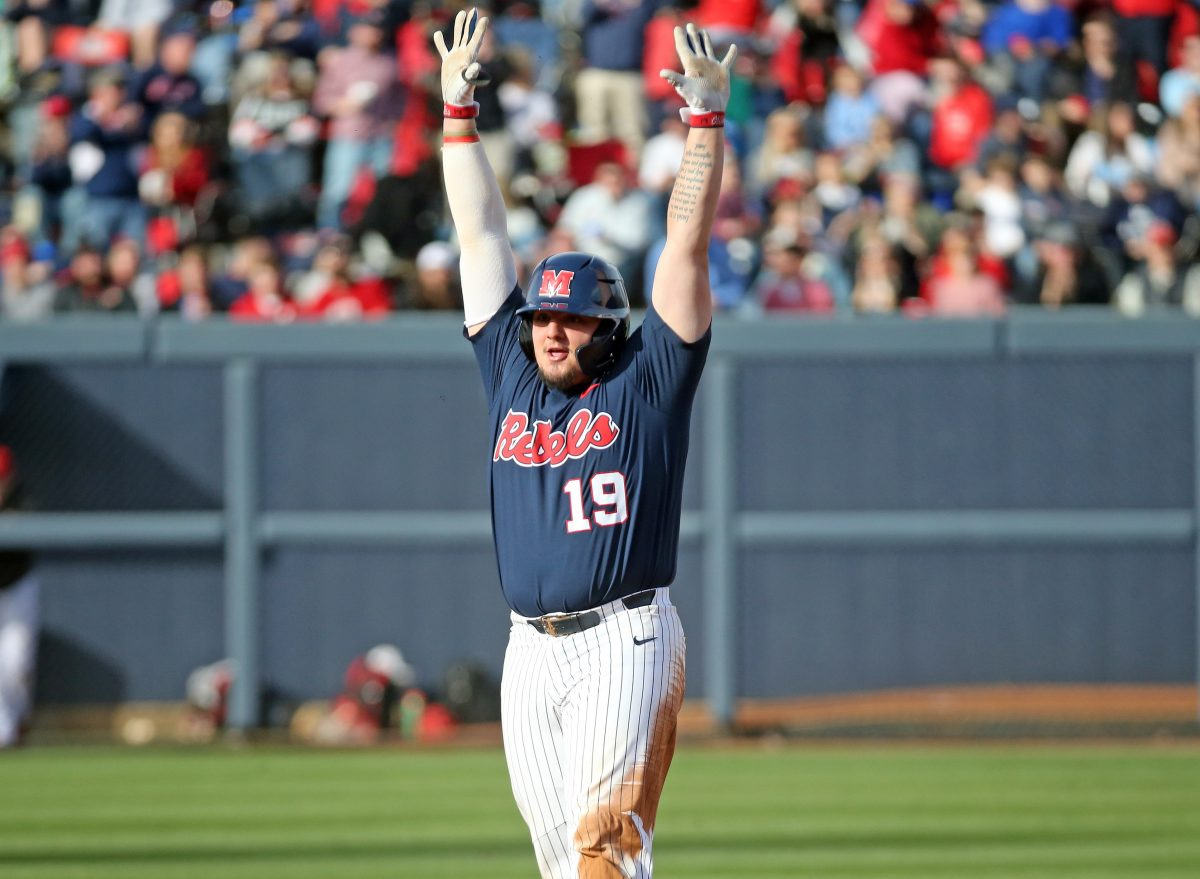 Baker's four-hit day powers Ole Miss to 8-6 win over No. 1 Louisville, evens series